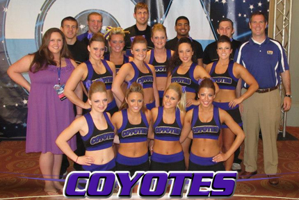 The Coyote cheer team along with incoming KWU President Dr. Matt Thompson