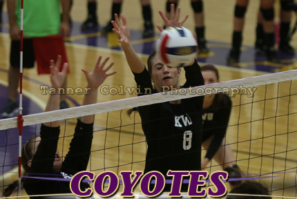 Melissa Blair blocks a Bellevue attack during Saturday's match at Mabee Arena. Blair is the all-time blocks leader at KWU
