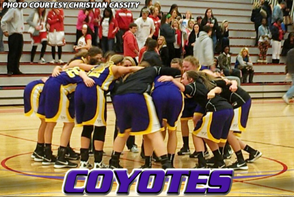 The Coyotes celebrate at center court after knocking off No. 1 seeded Friends 66-49 on Saturday night in Wichita